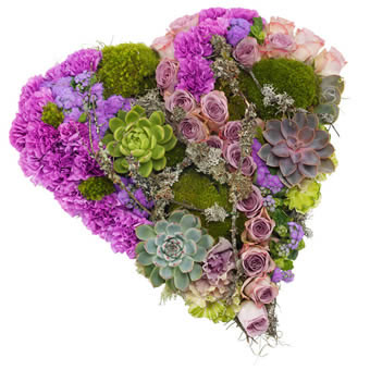 Heart-shaped funeral decoration in purple colours.