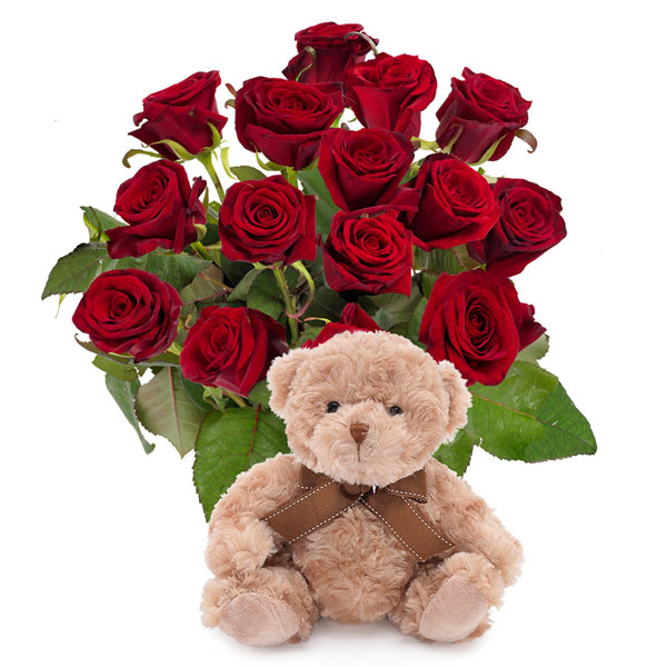 Beautiful bunch of red roses with teddy bear